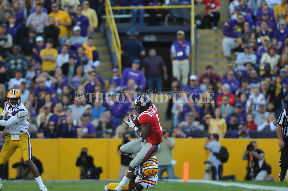 Ole Miss' Randall Mackey (1) vs. LSU safety Eric Reid (1) at Tiger Stadium in Baton Rouge, La. on Saturday, November 17, 2012.....