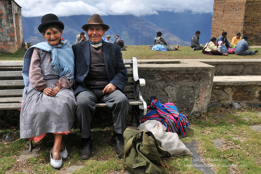 Elderly Bolivian couple waiting for the bus near Tacacoma, Bolivia