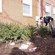 Volunteer Neftali Colon (17) seen working during The Delaware Valley Development Company Inaugural Trash to Cash event Monday, Jan 19, 2015 in Wilmington, Del.