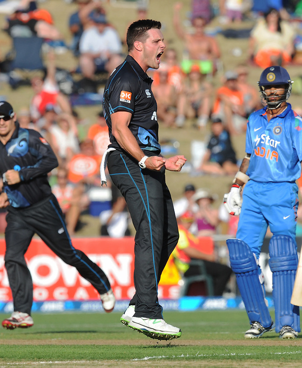 New Zealand's Mitchell McClenaghan celebrates dismissing India's Rohit Sharma for 3 in the first one day International cricket match, McLean Park, New Zealand, Sunday, January 19, 2014. Credit:SNPA / Ross Setford