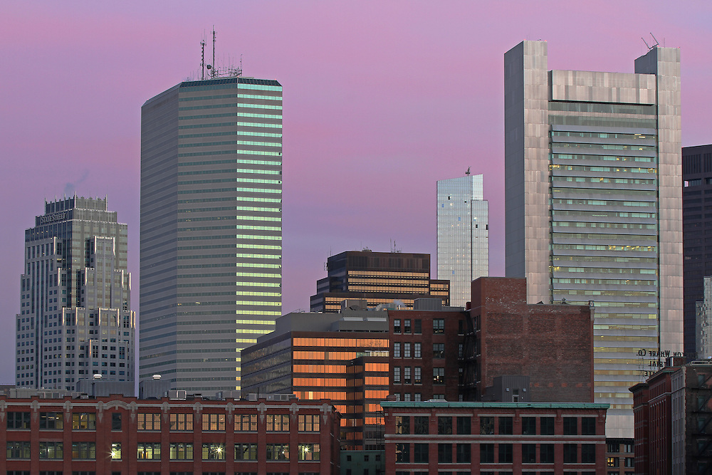 Boston skyline photography featuring iconic skyscrapers and some of the tallest buildings in Boston such as the Boston State Street Corporation, The Federal Reserve Bank of Boston, the Boston Millennium Tower and the One Financial Center at Dewey Square on a magnificent morning at dawn. This Boston skyline photograph at dawn is available as museum quality photography prints, canvas prints, acrylic prints or metal prints. Fine art prints may be framed and matted to the individual liking and decorating needs:<br />