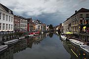 Dusk looking north over the River Leie in Ghent, in the East Flanders region of Belgium