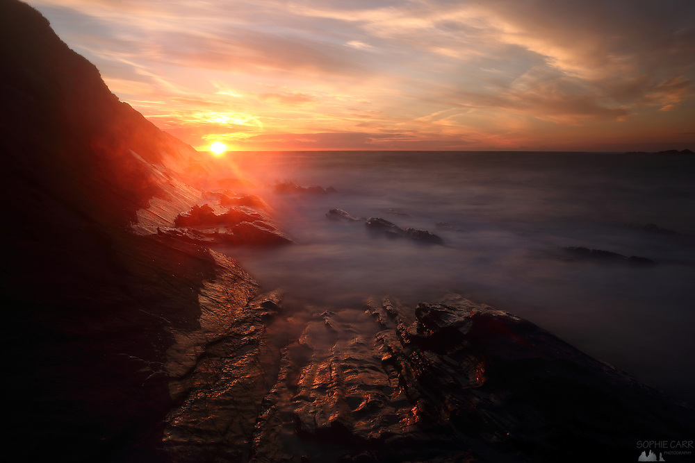 Sunset over Crackington Haven beach in northern Cornwall
