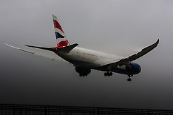 "January 3rd 2015, Heathrow Airport, London. Low cloud and rain provide ideal conditions to observe wake vortexes and ""fluffing"" as moisture condenses over the wings of landing aircraft. With the runway visible only at the last minute, several planes had to perform a ""go-round"", abandoning their first attempts to land. PICTURED: A British Airways Boeing 787 Dreamliner prepares to land on Heathrow's runway 27L"