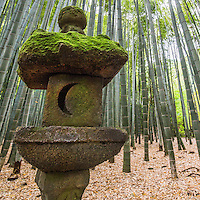 "Stone Lantern at Hokoku-ji Bamboo Garden - Hokoku-ji Kamakura is world famous for its bamboo garden containing more than 2000 Moso bamboos trees. Its nickname is Take-dera ""Bamboo Temple"" for that reason.  The bamboo garden is punctuated with stone lanterns, jizo and moss covered stones.  Besides the popular bamboo garden, and teahouse, Hokokuji also has a often overlooked Zen garden   Ashikaga Ietoki, ordered Zen priest Tengan Eko to establish Hokoku-ji. This temple became the family temple of the Ashikaga clan. Tengan was a disciple of Mugaku Sogen a contemporary of famous garden designer Muso Kokushi."