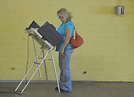 Lorene McGee votes in a primary runoff election at the old National Guard Armory in Oxford, Miss. on Tuesday, August 23, 2011. (AP Photo/Oxford Eagle, Bruce Newman)