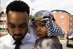 Finsbury Park, London, July 17th 2015. Two year old Zacharaiah Nichols in his best dress poses for pictures outside Finnsbury Park Mosque in North London.