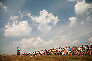 Tiger Woods and his gallery watch his tee shot on the par-three eighth hole during the third round of the 2007 U.S. Open Championship at Oakmont Country Club in Oakmont, Pennsylvania on Saturday, June 16 2007. Photograph by Darren Carroll .