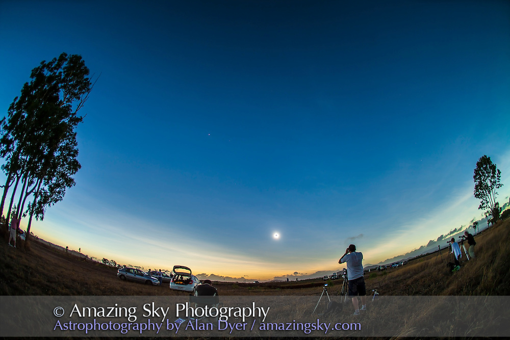 The total eclipse of the Sun, November 14, 2012, from a site near Lakeland Downs, Queensland, Australia. Shot with the Canon 5D Mark II and 15mm lens for a wide-angle view showing the Moon's conical shadow darkening the sky and the twilight glow on the horizon. Taken near mid-eclipse.