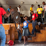 The tiny school is flooded with motion between classes, including in the main classroom where students rearrange chairs for each lesson.