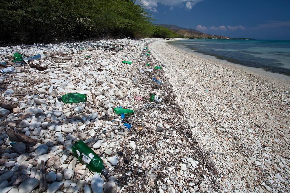 Bottles litter a beach on the south of Ile de La Gonave in Haiti