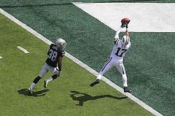 EAST RUTHERFORD, NJ - SEPTEMBER 7: Greg Salas (17) of the New York Jets attempts to catch a pass over T.J. Carrie (38) of the Oakland Raiders during the first quarter at MetLife Stadium on September 7, 2012 in East Rutherford, NJ.  (Photo by Ed Mulholland/Getty Images) *** Local Caption *** Greg Salas; T.J. Carrie