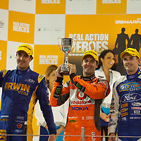 YAS V8 400 and BY GP2 ASIA SERIES in yas marina circuit, abu dhabi UAE.11-12 february 2011.winners Jamie Whincup - team vodaphone (1), Alex davidson - irwin racing (2), makr winterbottom - orrcon steel fpr falcon (3)...real action heroes event..Providing the action for the main event are the Australian V8 Supercars, a two-car series of makers Holden and Ford - a close rivalry that runs deep in Australian culture. This season, that rivalry is heightened by the switch of 2010 series Champion James Courtney, who drives with the coveted No.1 plate, from his winning 2010 Ford Falcon to the Holden Commodore for 2011.