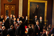 A republican congressman waves to someone in the crowd prior to congressmen being sworn in to office at the United States Capital in Washington, DC on Wednesday, January 5, 2011.