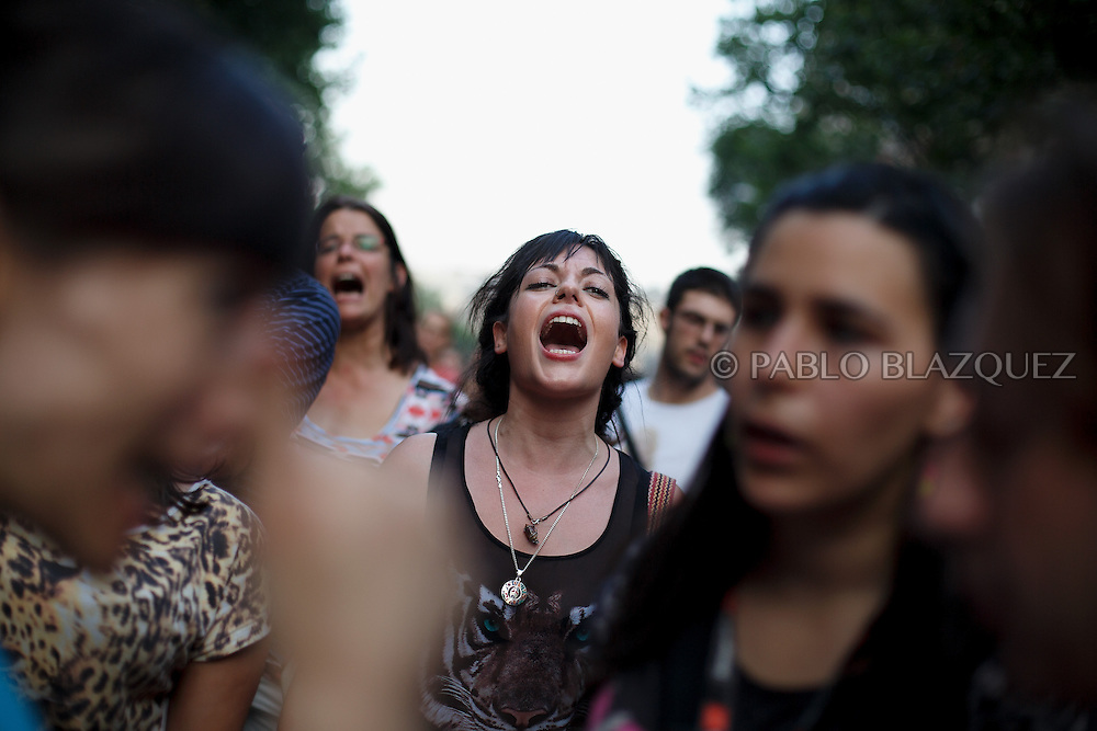 Protestors shout slogans during a demonstration against the Spanish government, on Thursday, July 18, 2013, in Madrid, Spain. Thousands demonstrators demanding the resignation of Prime Minister Mariano Rajoy and its party gathered in front of the People's Party headquarter. Rajoy rejected demands to resign after more alleged secret payments and test messages related to former political party treasurer Luis Barcenas under investigation appeared. The spectacle of alleged greed and corruption has enraged Spaniards hurting from austerity and sky high unemployment.