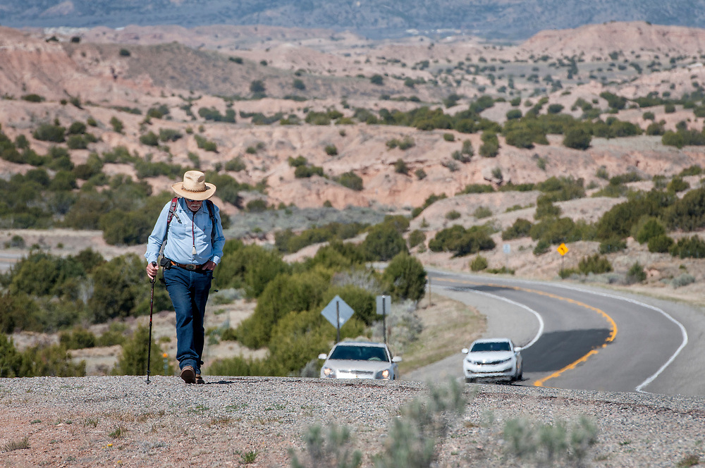 em041317d/jnorth/Ed Khmara, from Santa Fe, walks along Highway 503 through on his way to the Santuario de Chimayo Thursday April 13, 2017. Hundreds of people were making their pilgrimage to the Northern New Mexico church on Thursday, thousands will on Good Friday.   (Eddie Moore/Albuquerque Journal