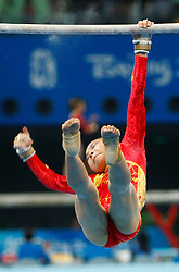 China's He Kexin loses her grip on the uneven bars during the artistic gymnastics women's qualifications in the National Indoor Stadium during the Olympic games in Beijing, China, 10 August 2008.