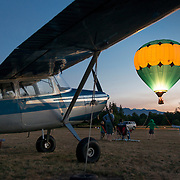 On blue moon Friday, Captain Crystal Stout flies her tethered hot air balloon at Sequim airport, with it glowing like a magic lantern. Families watched and kids danced.