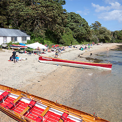 Pilot gig boats on the beach at Flushing and Mylor Gig Regatta, Flushing, Cornwall, UK