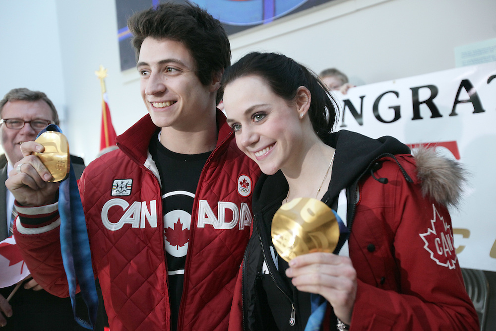 London, Ontario ---02/03/10--- Olympic Gold Medalists in Ice dance Scott Moir and Tessa Virtue pose for photos with their medals as they are welcomed home by fans and family at the airport in London, Ontario, March 2, 2010.<br /> CP PHOTO/'GEOFF ROBINS
