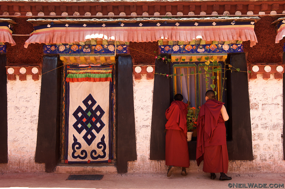 Tibetan nuns visit another in her quarters on the roof of the Jokhang in Lhasa, Tibet.
