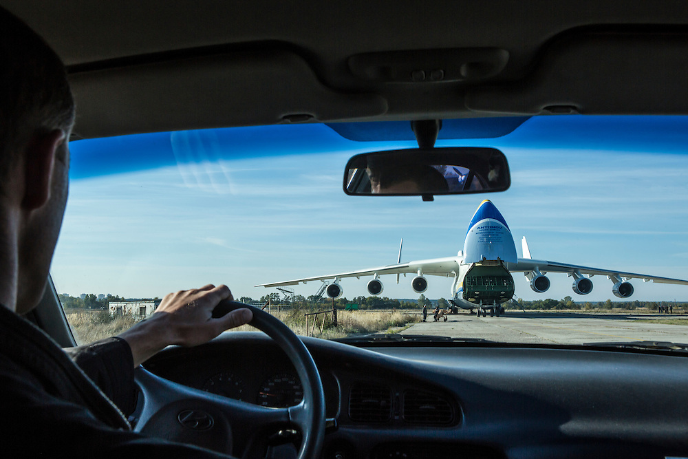 GOSTOMEL, UKRAINE - OCTOBER 1, 2014: The Antonov AN-225, the longest and heaviest airplane ever built, is seen through the windshield of an Antonov company car on an airfield in Gostomel, outside Kiev, Ukraine. CREDIT: Brendan Hoffman for The New York Times