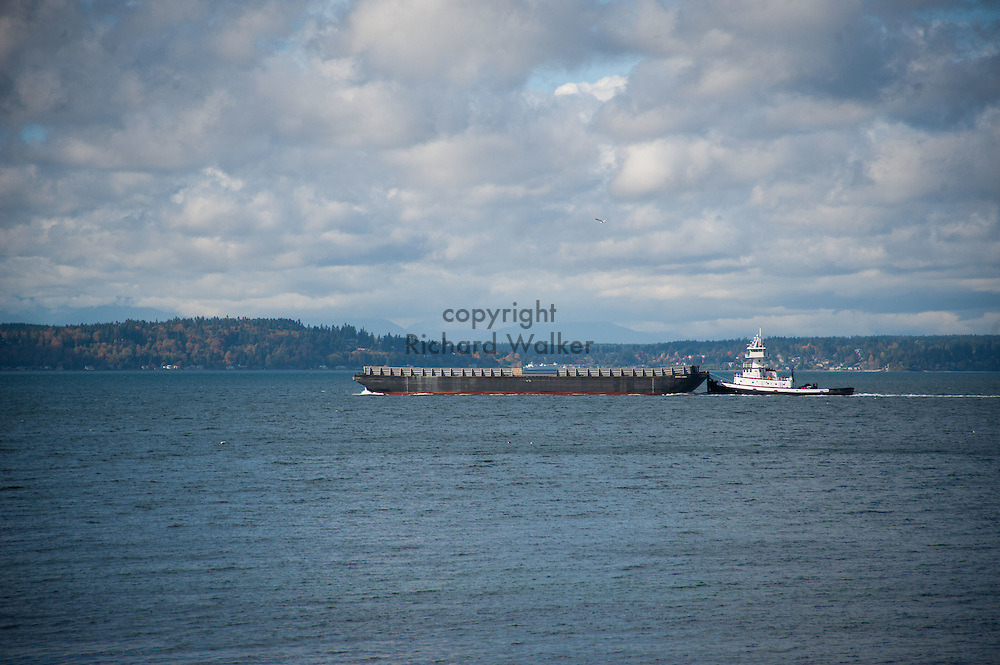2016 October 18 - View of tugboat and barge on Puget Sound along the shore at Alki, West Seattle, WA, USA. By Richard Walker