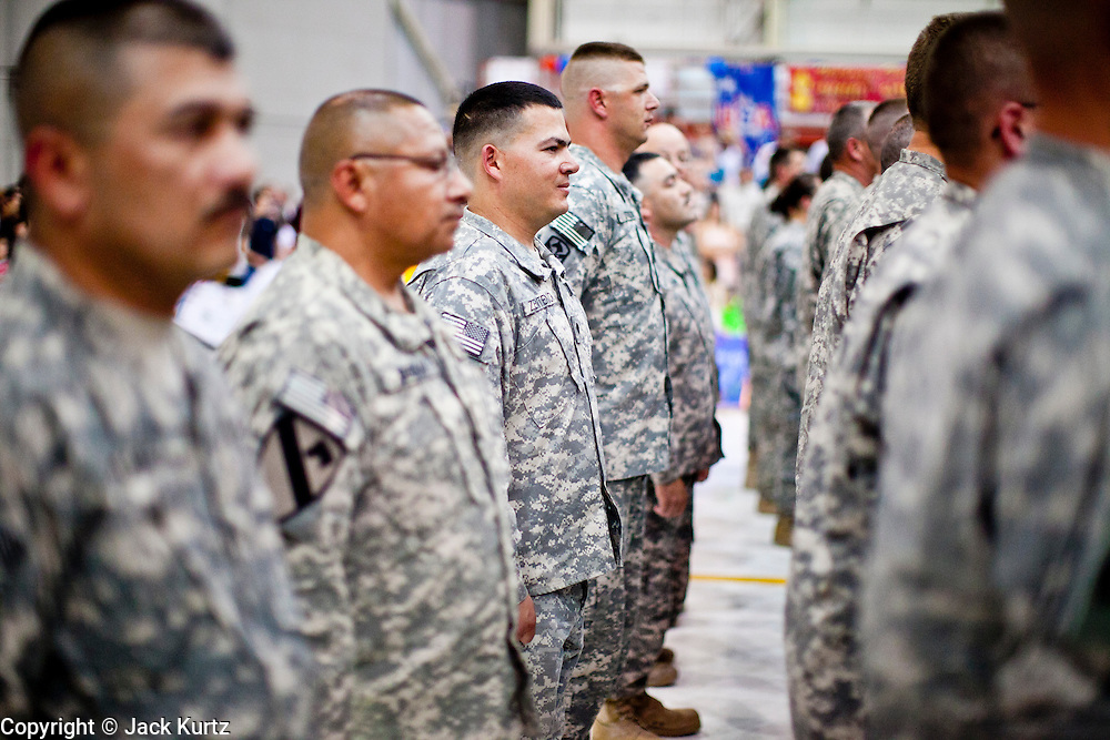 16 JUNE 2010 - PHOENIX, AZ: Returning soldiers stand at attention in the 161st Air Refueling Wing hangar at Sky Harbor Airport in Phoenix Wednesday. Members of the 3666th Maintenance Company (CQ) of the Arizona Army National Guard returned to Phoenix Wednesday after serving in Iraq (CQ).   PHOTO BY JACK KURTZ