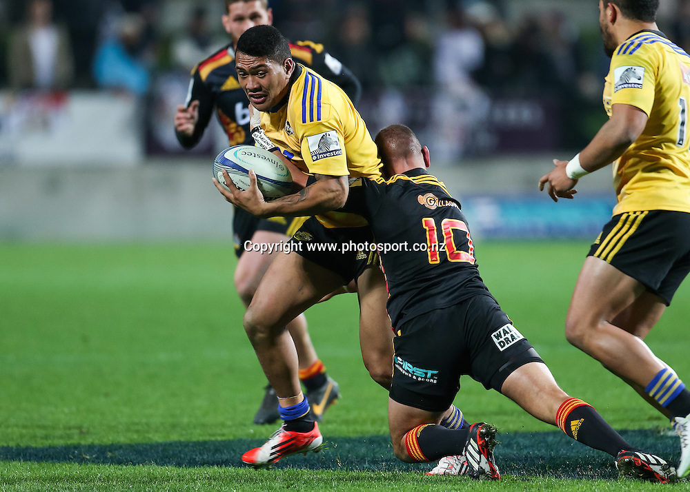 Hurricanes' Ardie Savea is tackled by Chiefs captain Aaron Cruden during the Super 15 Rugby match - Chiefs v Hurricanes at Waikato Stadium, Hamilton, New Zealand on Friday 4 July 2014.  Photo:  Bruce Lim / www.photosport.co.nz