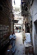 """Narrow streets of the historical """"Old City' sector of Lahore, Pakistan."""