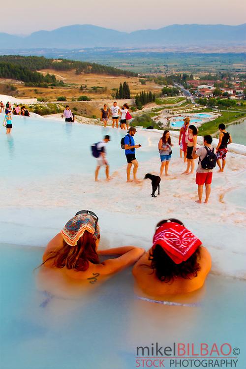 Travertine terrace formations and tourists. Pamukkale. <br /> Denizli province. Anatolia. Turkey.