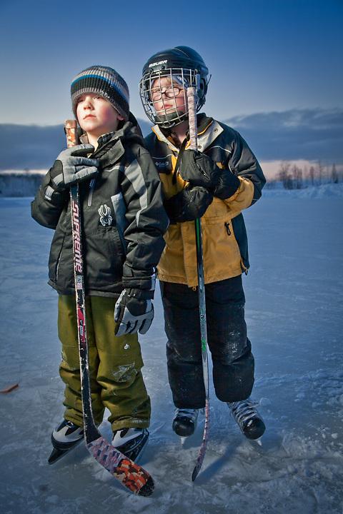 Young hockey enthusiasts, Paul Mekhert, age 6, and Noah Flanum, age 7, Westchester Lagoon, Anchorage.                   Photographer: Clark Mishler