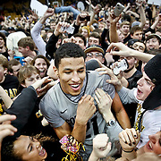 SHOT 2/14/13 10:01:30 PM - Colorado's Andre Roberson #21 celebrates with fans after upsetting Arizona during their regular season Pac-12 basketball game at the Coors Event Center on the Colorado campus in Boulder, Co. Colorado won the game 71-58. (Photo by Marc Piscotty / © 2013)