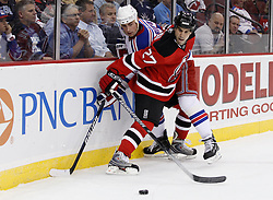 Oct 5, 2009; Newark, NJ, USA; New Jersey Devils defenseman Mike Mottau (27) checks New York Rangers center Brandon Dubinsky (17) during the first period at the Prudential Center.