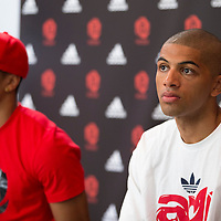 12 July 2013: Portrland Trail Blazers Nicolas Batum is seen next to Bulls superstar Derrick Rose as they answer journalists during Adidas' D Rose tour,  in Paris, France.