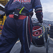 Redbull racing team member moving tires  during the Sprint Cup Series AAA 400 Sunday, Oct. 02, 2011 at Dover International Speedway in Dover Delaware.