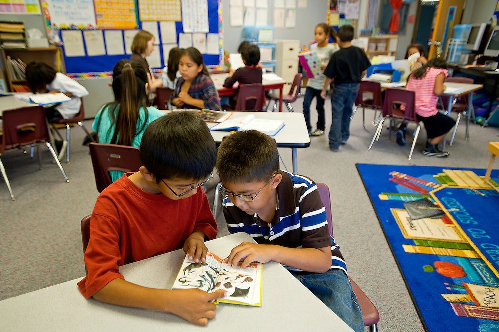 081810       Brian Leddy.Ganado Primary School third-graders Lyle Tsosie and Kyran Begay read a book together on Wednesday. The school has made it's annual Adequate Yearly Progress for the fifth year in a row.