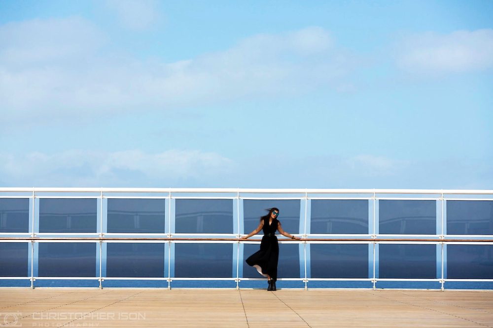 Bonnie Rakhit, aka The Style Traveller wears Amanda Wakeley on board Queen Mary 2 during the first ever Transatlantic Fashion Week voyage to New York.<br /> Picture date: Wednesday September 7, 2016.<br /> Photograph by Christopher Ison &copy;<br /> 07544044177<br /> chris@christopherison.com<br /> www.christopherison.com