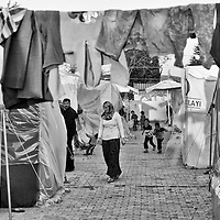 A Syrian refugee walks inside a refugee camp in Reyhanli, Turkey, Saturday, March 17, 2012. The number of Syrian refugees in Turkey is now about 17,000. March 2012.