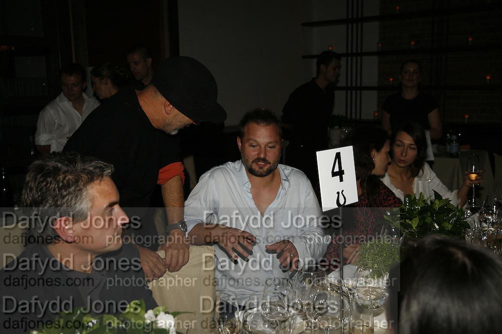 Ron Arad and Juergen Teller, Cartier Frieze dinner, Berkeley St. London. 12 October 2006. -DO NOT ARCHIVE-© Copyright Photograph by Dafydd Jones 66 Stockwell Park Rd. London SW9 0DA Tel 020 7733 0108 www.dafjones.com