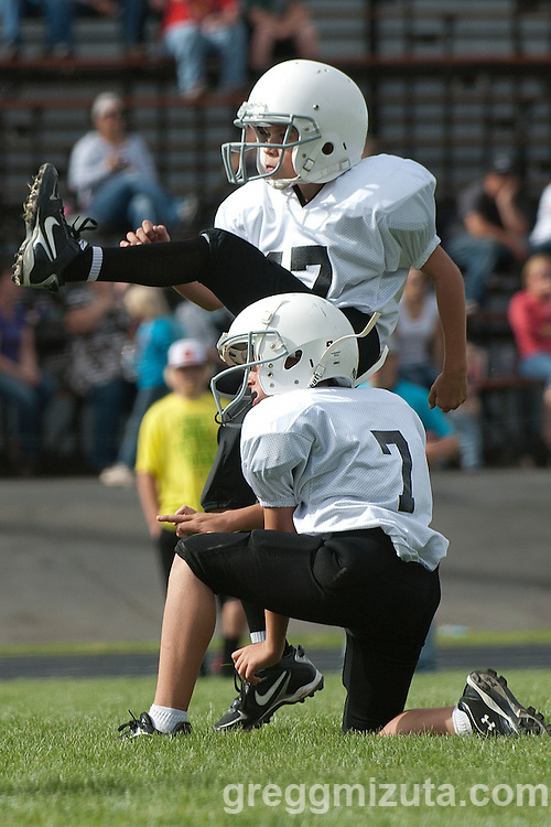 Wade Bond attempts an extra point with Jared Fulwyler as the holder during the Vale Broncos vs Vale Cowboys championship game. The two Vale teams met in the Eastern Oregon Youth Football Championship game at Frank Hawley Stadium in Vale, Oregon on October 13, 2012. The Broncos won the games 7 - 6.