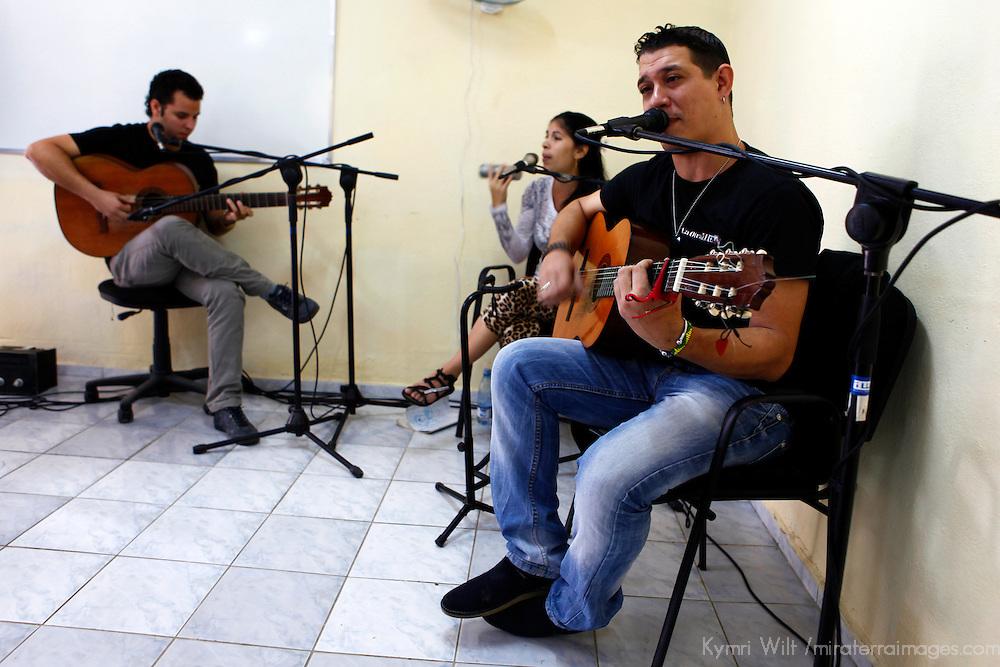 Central America, Cuba, Havana. Cuban Community band, La Otra Mitad, performs at Projeto Todos Las Manos Community Center in a barrio of Havana.
