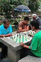 Rizal Park Chess Square - The park in modern times has become a local spot for families to have picnics on Sundays and holidays and a major tourist attraction of Manila. It has a small man-made lake with a replica of the Philippine archipelago in the middle. Other attractions of Rizal Park include the Chinese Gardens, the National Museum of the Filipino People, the Orchidarium,  a children's lagoon and even a chess plaza.