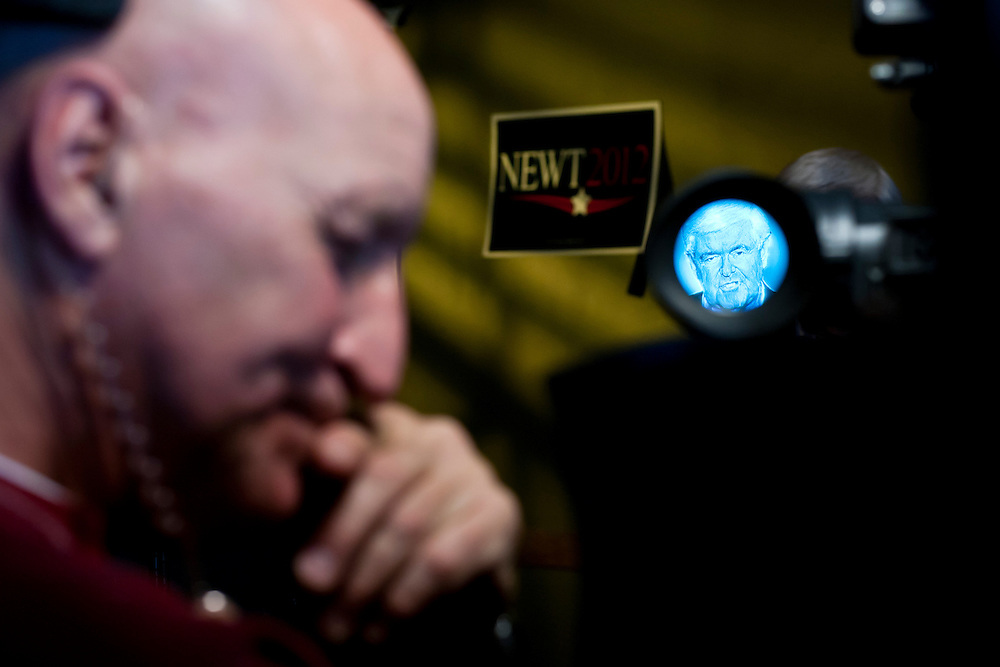 Republican presidential candidate Newt Gingrich is seen through a television camera viewfinder as he tapes a segment for FOX News before meeting with voters at the West Towne Pub on Sunday, January 1, 2012 in Ames, IA.