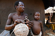 October 6, 2006 - A man makes rope out of an old grain bag in Coope camp for internally displaced people, or IDP, near Gulu in north Uganda. Coope, with a population of 18,000, is one of 76 IDP camps around Gulu, the main base for the Uganda Peoples Defense Force fighting the insurgent Joseph Kony's Lord's Resistance Army. Kony's LRA movement has been fighting for the past 20 years to force the East African country to be ruled according to the Christian Ten Commandments. Over 2 million people, mostly of the Acholi tribe, have moved or were forced to move from their villages to camps close to the towns of Gulu, Lira, and Kitgum where they are watched over by the Ugandan Army. The LRA rebels have abducted thousands of children and have forced them to fight against the Ugandan Army and the Acholi people. Current peace talks between Kony's LRA and the Ugandan government held in Juba, southern Sudan, offer a glimpse of hope to ending this ongoing conflict..(Photo by Jakub Mosur/Polaris)<br />