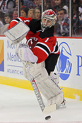 Mar 13, 2013; Newark, NJ, USA; New Jersey Devils goalie Johan Hedberg (1) plays the puck during the second period of their game against the Philadelphia Flyers at the Prudential Center.