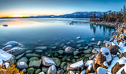 """""""Tahoe Boulders at Sunset 17"""" - Stitched panoramic sunset photograph of snow covered boulders along the shore of Lake Tahoe, near Hidden Beach."""