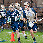 Ryan Mix Attack #33 and Brian Buglione Defense #25 take to the field before gam ewith Duke.The third-ranked Fighting Irish defeated sixth-ranked Duke, 13-5, in men's lacrosse action on a snowy Saturday afternoon at Koskinen Stadium in Durham, N.C.