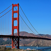Golden Gate Bridge in San Francisco, California<br /> The iconic Golden Gate Bridge is unquestionably the most recognizable suspension bridge in the world.  Since 1937, most people walked along Crissy Field near Fort Point in Presidio park to get this view or they drove, walked or rode a bike across the nearly 9,000 foot length.  But in 2012 the Golden Gate Bridge Pavilion opened.  It offers a splendid observation area, bike and walking paths plus educational exhibits.