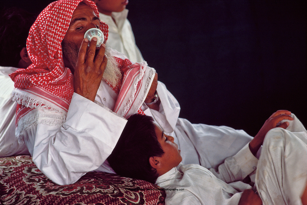 Shaikh Hamad bin Amer Alerq drinking coffee, ever present, even during the hottest part of the day, Al Murrah in the Dahana Sands, Saudi Arabia
